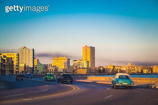 Old Cars along the Malecom in Havana - gettyimageskorea