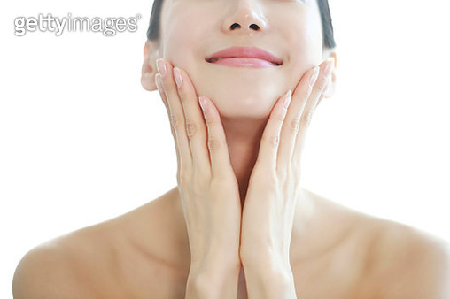 Woman touching Face - gettyimageskorea