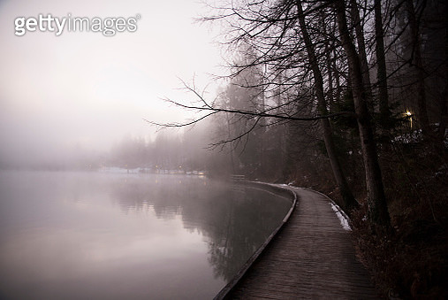 Bled, Slovenia december 7, 2017: Quiet image of bohinj lake reflections in a clear winter scene in Slovenia. - gettyimageskorea