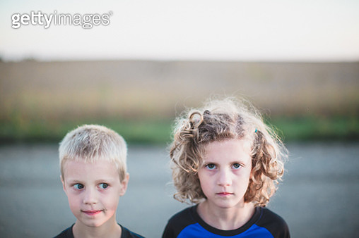 Boy and girl side by side - gettyimageskorea