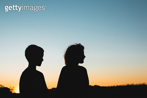 silhouette of boy and girl - gettyimageskorea