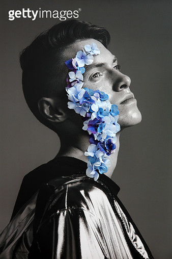 Collage with male portrait and blue flowers - gettyimageskorea