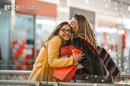 Sisters sharing Christmas presents - gettyimageskorea