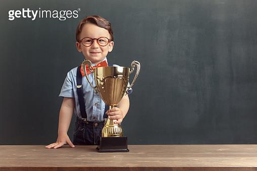 Little boy holding a golden trophy - gettyimageskorea