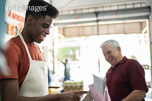 Happy cashier working at wholesale - gettyimageskorea