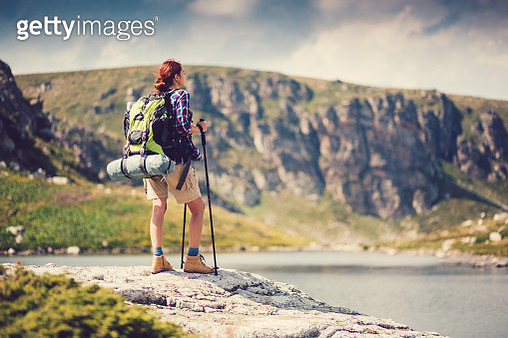 Woman in the mountain enjoying the landscape - gettyimageskorea