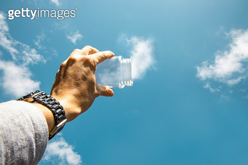 Dreamlike picture capturing clouds with glass pot. - gettyimageskorea