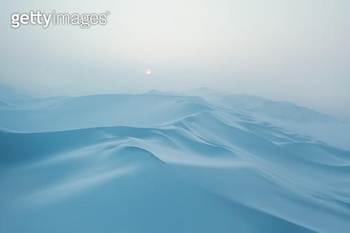 Snow covered desert sand dunes at sunset in winter - gettyimageskorea