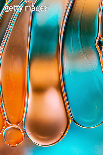 Vibrant and colourful abstract macro image of oil drops floating on water - gettyimageskorea