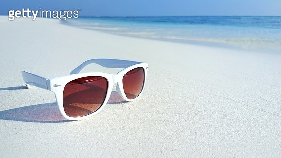 White sunglasses left on the beach in summer - gettyimageskorea