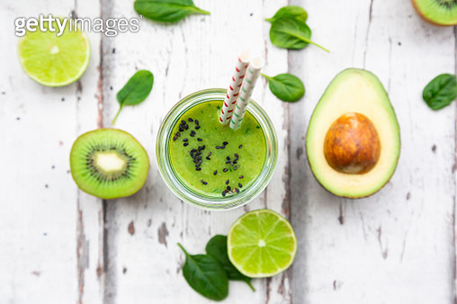 Glass of green smoothie with avocado, spinach, kiwi and lime - gettyimageskorea