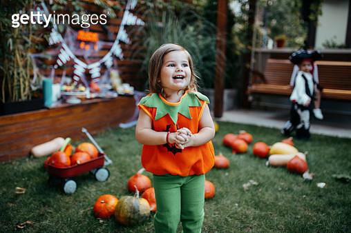 Playful kids enjoying a Halloween party - gettyimageskorea