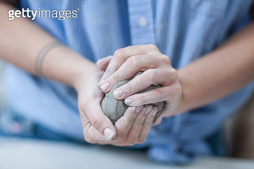 Female potters hands shaping clay in workshop - gettyimageskorea