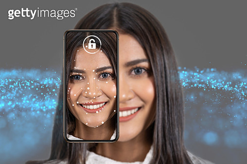 Asian Woman Face detection and recognition by smart mobile phone for unlock over the Technology background, Biometric Verification,  Computer vision and artificial intelligence concept - gettyimageskorea