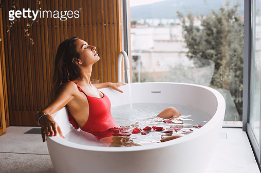 Woman Relaxing In Bathtub At Bathroom - gettyimageskorea