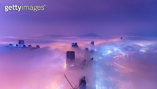 Qingdao city in the mist at night - gettyimageskorea