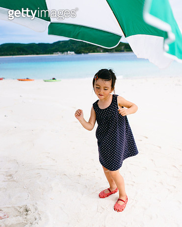 Adorable mixed race little girl dancing on beach, Okinawa, Japan - gettyimageskorea