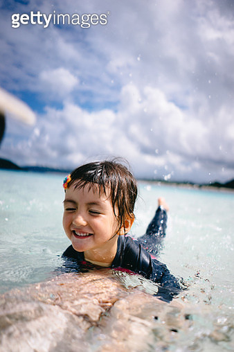 Little girl playing in shallow tropical water, Okinawa, Japan - gettyimageskorea