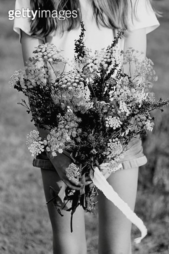 Close Up Of Wild Flower Posy With Teenager Midsection - gettyimageskorea