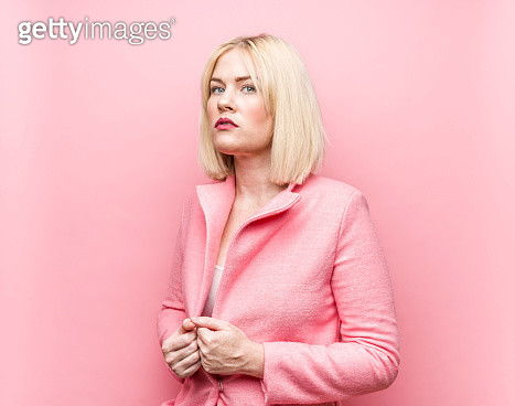 Blonde woman wearing pink overcoat - gettyimageskorea