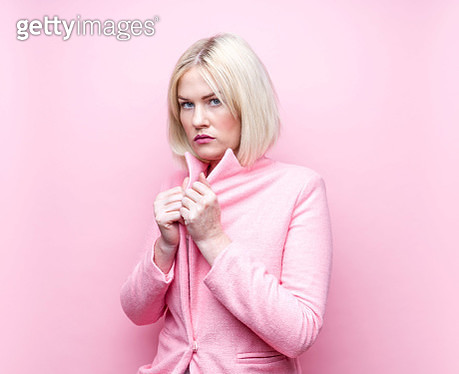 Blonde woman wearing pink overcoat - gettyimageskorea