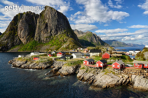 Scenic view of sea by buildings against sky,Reine,Norway - gettyimageskorea