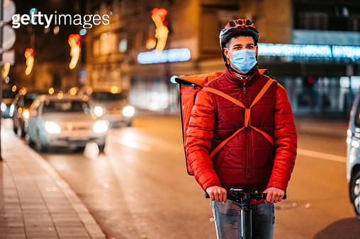 Delivery man driving electric scooter - gettyimageskorea