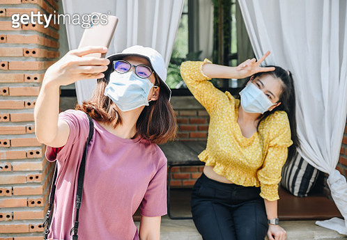 Conceptual of new normal lifestyle of peoples when they want to take a selfie. - gettyimageskorea