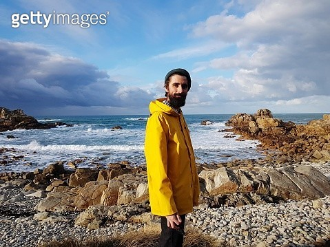 Portrait Of Smiling Mid Adult Bearded Man Standing On Beach Against Sky - gettyimageskorea