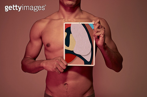 Young man holding tablet in front of chest to display lung - gettyimageskorea