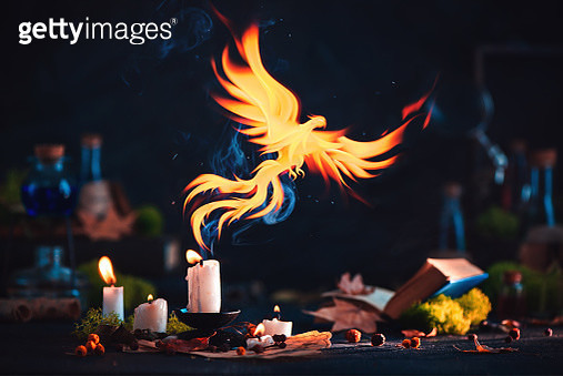Phoenix with a magical candle. Fantasy artifact photography. Dark still life with copy space. - gettyimageskorea