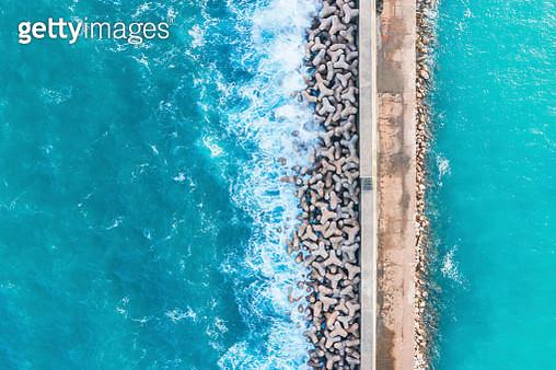 Portugal, Algarve, Sagres, harbor, aerial view of tetrapods as coastal protection - gettyimageskorea