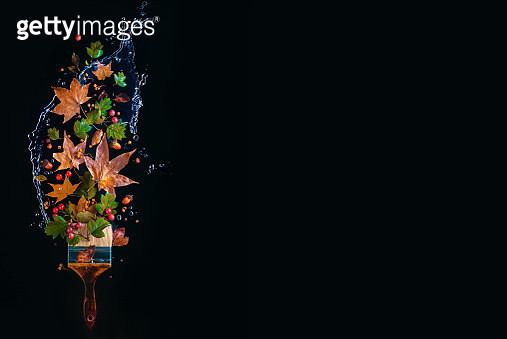 Dark painting fall concept with paintbrush, water splash, flying autumn leaves and acorns. Creative seasonal header on a dark background with copy space - gettyimageskorea