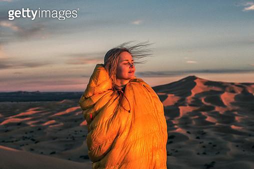Admiring desert sunset - gettyimageskorea