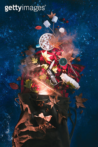 Adventurer backpack with travel essentials, a cup of cocoa with marshmallows and autumn leaves. Explorer flat lay concept - gettyimageskorea