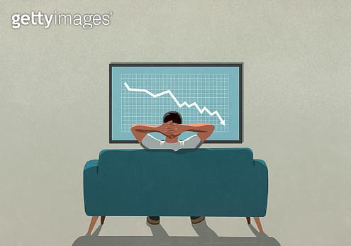 Man on sofa watching stock market decline on TV - gettyimageskorea