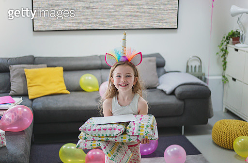 Excited young girl with birthday presents - gettyimageskorea