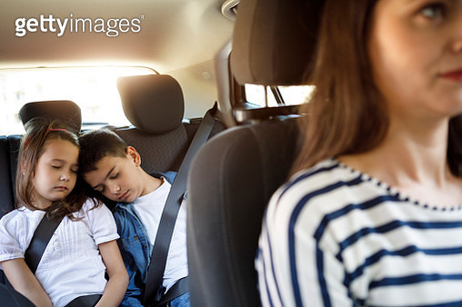 Siblings sleeping in the car - gettyimageskorea