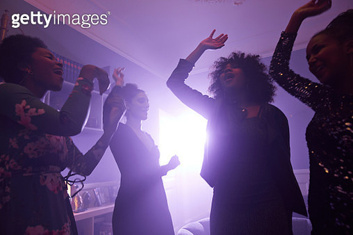 Young women having party in apartment - gettyimageskorea