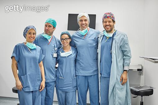 Portrait of smiling surgeons standing in ICU - gettyimageskorea