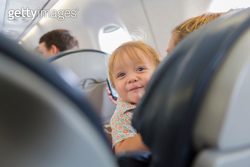 Caucasian baby laughing on airplane - gettyimageskorea