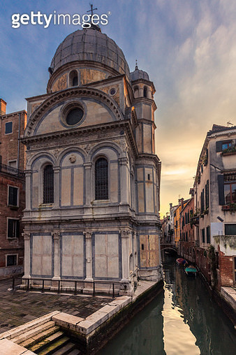 Venetian cathedral rises by the canal - gettyimageskorea