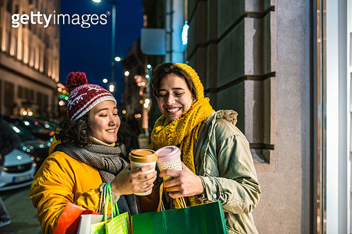 Happy two young womanare walking and having a great time while shopping - gettyimageskorea
