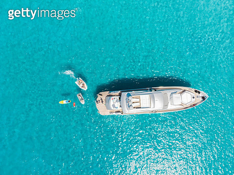 Aerial view of luxury yacht anchored in the transparent sea of the Formentera island in Spain. - gettyimageskorea