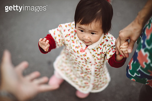 First person view of dad looking at his lovely little baby reaching out her little hand to himself. - gettyimageskorea