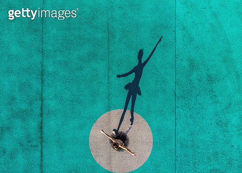 Drone view of creative picture of ballerina stands out from circle with color. - gettyimageskorea