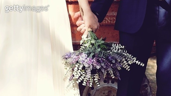 Midsection Of Couple Holding Bouquet - gettyimageskorea