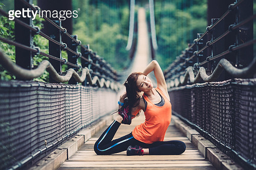 Young woman sports training at the rope bridge - gettyimageskorea