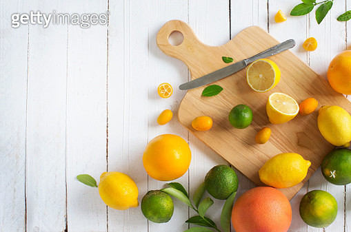 Citrus fruits family on rustic white wooden background. Horizontal view. Text space images. - gettyimageskorea