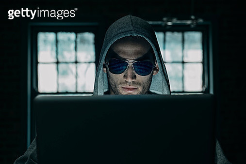 Young Man Committing Computer Crime - gettyimageskorea